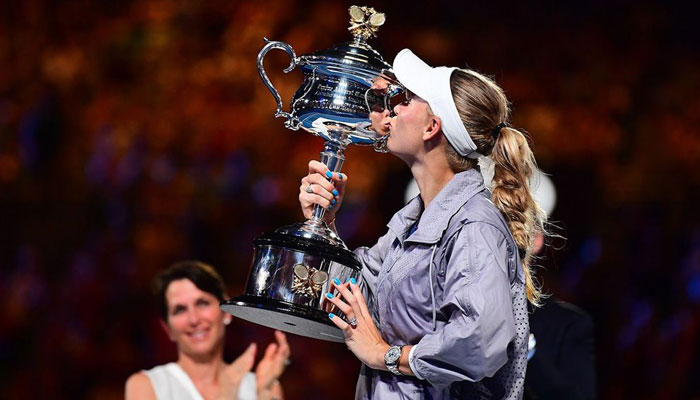 Emotional Wozniacki wins first major at Australian Open