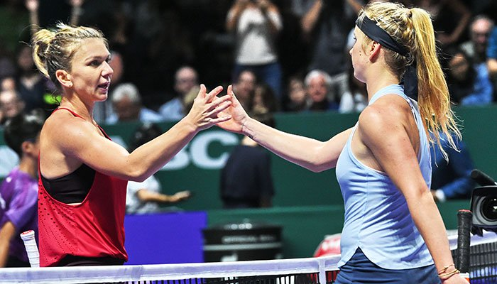 Top-ranked Halep crashes out of WTA Finals